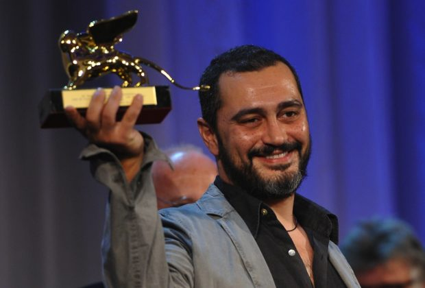 """Italian film director Guido Lombardi poses with the Lion of the Future """"Luigi de Laurentiis"""" Venice award he received for """"La-Bas"""" during the award ceremony at the 68th Venice Film Festival on September 10, 2011 at Venice Lido. AFP PHOTO / ALBERTO PIZZOLI (Photo credit should read ALBERTO PIZZOLI/AFP/Getty Images)"""